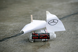 Motorsports / Formula 1: World Championship 2010, GP of Japan, mechanics play with paper boats during heavy rain in qualifying