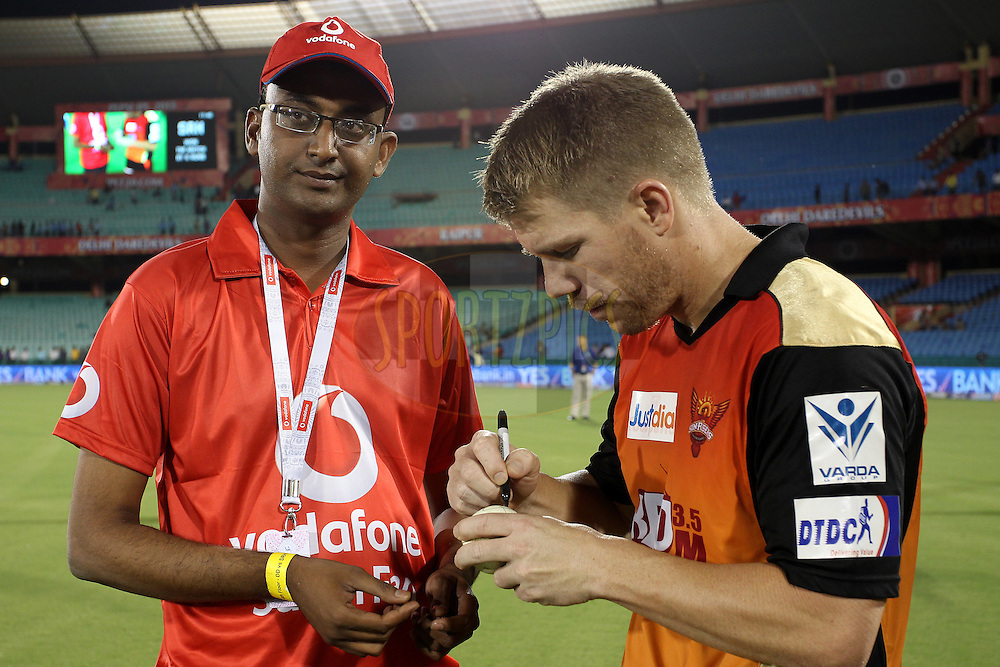Sunrisers Hyderabad captain David Warner signs the Match ball for the Vodafone Superfan during match 45 of the Pepsi IPL 2015 (Indian Premier League) between The Delhi Daredevils and the Sunrisers Hyderabad held at the Shaheed Veer Narayan Singh International Cricket Stadium in Raipur, India on the 9th May 2015.<br /> <br /> Photo by:  Shaun Roy / SPORTZPICS / IPL
