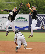 Owasso's Ryan Mayfield successfully steals second as Broken Arrow's Spencer Barnett (left) and Cale Replogle go airborne to catch the high throw from the plate in Claremore, OK.