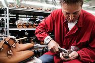 Corridonia, Marche - Operai del calzaturificio Santoni a lavoro. Tutti gli operai sono altamente specializzati. Dalla scelta del pellame e del cuoio, al taglio della pelle, dalla velatura alla lucidatura. Ogni singola calzatura e fatta a mano. Le scarpe Santoni rappresentano il vero made in Italy.<br /> Ph. Roberto Salomone