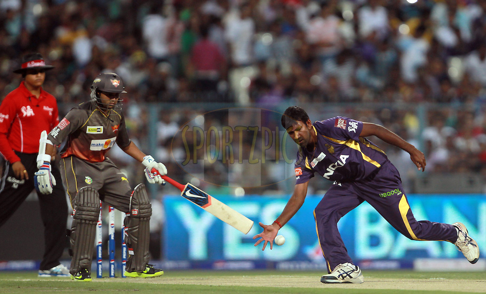 Laksmipathy Balaji fields off his own bowling during match 17 of the Pepsi Indian Premier League between The Kolkata Knight Riders and the Sunrisers Hyderabad held at the Eden Gardens Stadium in Kolkata on the 14th April 2013. Photo by Jacques Rossouw-IPL-SPORTZPICS ..Use of this image is subject to the terms and conditions as outlined by the BCCI. These terms can be found by following this link:..http://www.sportzpics.co.za/image/I0000SoRagM2cIEc