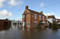 © Licensed to London News Pictures. Date 07/02/2014. Moorland, Somerset. Flooded house belonging to sister of farmer James Matthews. Evacuated village of Moorland in Somerset. All residents have been evacuated as the flood waters continue to rise today.. Photo credit : MarkHemsworth/LNP