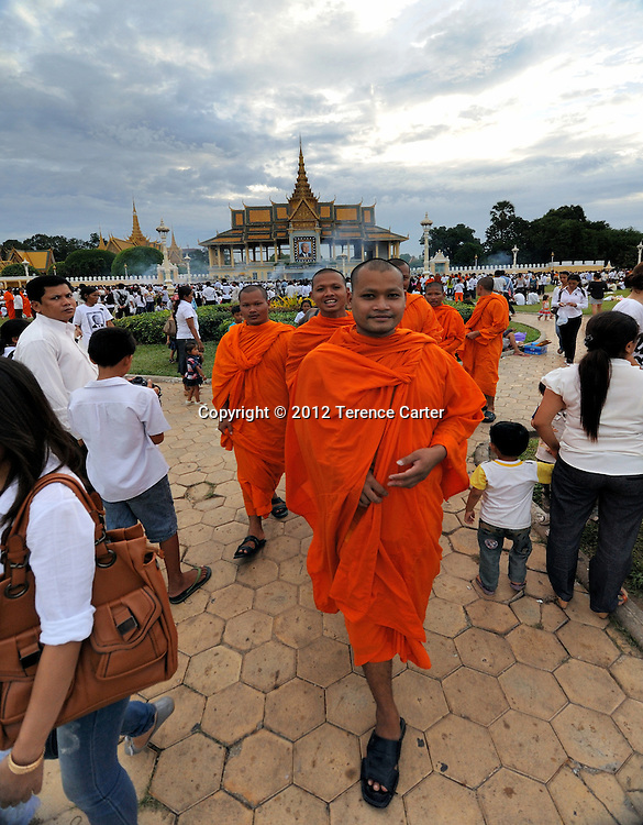 Monks leave the Royal Palace after King Father Norodom Sihanouk's body is returned to Phnom Penh, where a week of mourning was taking place.