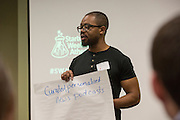 Harrison Mbemba, an Ohio University third-year senior, gives his pitch at Startup Weekend Athens at the Ohio University Innovation Center on March 18, 2016.