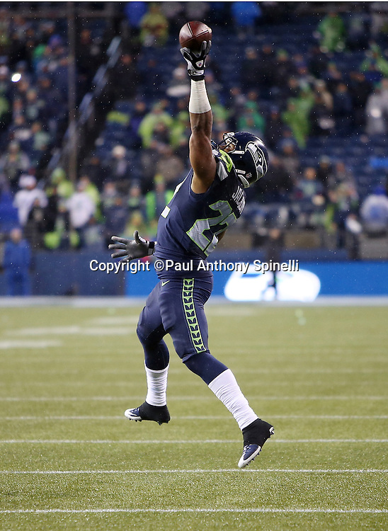 Seattle Seahawks running back Fred Jackson (22) jumps as he tries to catch a pass with one hand during the 2015 NFL week 16 regular season football game against the St. Louis Rams on Sunday, Dec. 27, 2015 in Seattle. The Rams won the game 23-17. (©Paul Anthony Spinelli)