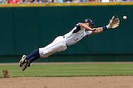Georgia Tech second basemen Mike Trapani dives for a line drive off the bat of Cal State Fullerton's John Curtis in the third inning.  Cal State Fullerton eliminated Georgia Tech with a 7-5 win at the College World Series at Rosenblatt Stadium in Omaha, Nebraska, June 18, 2006.