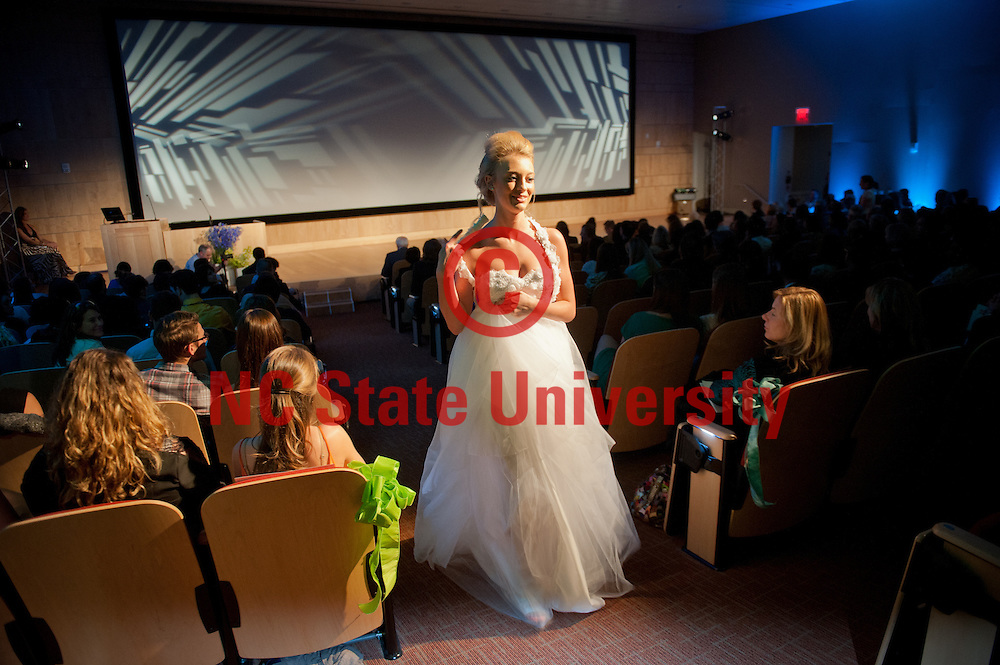 Students participate in 2013 Fashion Week festivities that kicked off with a fashion show at the Hunt Library. Photo by Marc Hall