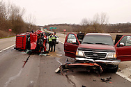 Ohio State Patrol troopers David Griffith (left) and Frank Simmons investigate an accident at the intersection of westbound US 35 and Trebein Road near Xenia, Saturday, March 26, 2011.