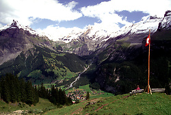 Kandersteg, Switzerland: (From Wikipedia: Kandersteg is a municipality in the district of Frutigen in the canton of Berne in Switzerland. It is located along the valley of the River Kander, west of the Jungfrau massif. It is noted for its spectacular mountain scenery and sylvan alpine landscapes. Tourism is a very significant part of its economic life today. It is a year round outdoors mecca for hiking trails and mountain climbing as well as downhill and cross-country skiing... .Kandersteg.It has been known since Roman times. In the 1860's it began to be developed as a tourist haven...The International Scout Centre is located at the edge of the village. More than 10,000 scouts from all over the world visit each year...The Gemmi Pass is a mountain pass that connects Kandersteg with Leukerbad, Valais. Cable cars operate at each end (in Kandersteg [[1]] and Leukerbad [[2]] ) to lift walkers up to the pass...Lake Oeschinen [[3]] is considered to be one of the most attractive in Switzerland and can be accessed by the Sesselbahn Kandersteg-Oeschinen chairlift from Kandersteg. Other attractions in the village include a 16th century parish church...The Lötschberg Tunnel is part of a major railway line across the Alps. Kandersteg is located at the north entrance to the tunnel through which trains run for 15 kilometres to emerge at Goppenstein in eastern Valais. Road vehicles are carried through the tunnel to Goppenstein by open sided shuttle trains. .