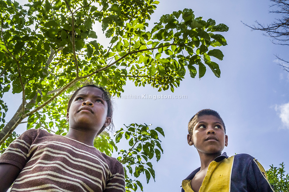 Low angle portrait of a boy and girl Miskito youth in Krin Krin, Nicaragua.