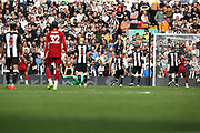 Liverpool forward Mohamed Salah (11) scores Liverpool's third goal 3-1 during the Premier League match between Liverpool and Newcastle United at Anfield, Liverpool, England on 14 September 2019.