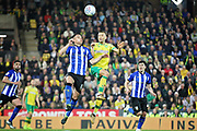 Sheffield Wednesday midfielder Joey Pelupessy (8) and Norwich City midfielder Moritz Leitner (10)  challenge for a header during the EFL Sky Bet Championship match between Norwich City and Sheffield Wednesday at Carrow Road, Norwich, England on 19 April 2019.