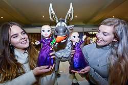 """© Licensed to London News Pictures. 13/11/2019. LONDON, UK. Staff present the Frozen 2 'Into the Unknown' Elsa Doll' from Jakks Pacific at the preview of """"DreamToys"""", the official toys and games Christmas Preview, held at St Mary's Church in Marylebone.  Recognised as the countdown to Christmas, the Toy Retailer's Association, an independent panel of leading UK toy retailers, have selected the definitive and most authoritative list of which toys will be the hottest property this Christmas.  Photo credit: Stephen Chung/LNP"""