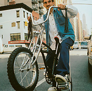 Man riding his Schwinn bike, USA
