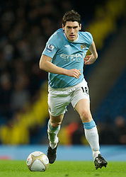 MANCHESTER, ENGLAND - Sunday, February 13, 2010: Manchester City's Gareth Barry in action against Stoke City during the FA Cup 5th Round match at the City of Manchester Stadium. (Photo by David Rawcliffe/Propaganda)  MANCHESTER, ENGLAND - Sunday, February 13, 2010: Manchester City xxxx and Stoke City's xxxx during the FA Cup 5th Round match at the City of Manchester Stadium. (Photo by David Rawcliffe/Propaganda)
