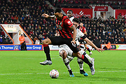 Callum Wilson (13) of AFC Bournemouth on the attack is challenged by Matty Pearson (6) of Luton Town during the The FA Cup match between Bournemouth and Luton Town at the Vitality Stadium, Bournemouth, England on 4 January 2020.