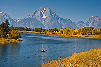 Canoeing at Oxbow Bend on the Snake River below 12,605 ft. Mount Moran.  Grand Teton National Park, Wyoming, USA.
