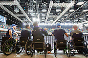 UNITED KINGDOM, London: 2015 World Wheelchair Rugby Challenge. Caption: Australian players watch the World Wheelchair Rugby Championship final game between USA and Canada from the middle concourse of the Copperbox Arena. Rick Findler / Story Picture Agency