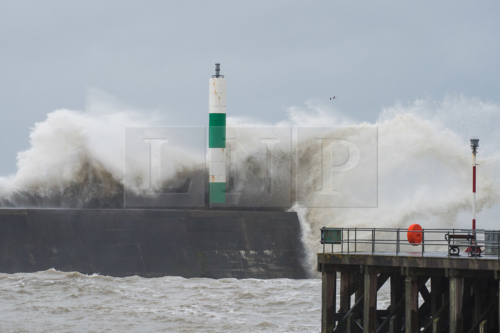 © Licensed to London News Pictures. 17/04/2018. Aberystwyth, UK. Strong gale force winds from the south west, and a 5.3m high tide, combine to generate huge waves  battering the seafront and harbour in Aberystwyth on the west coast of Wales this morning. Photo credit: Keith Morris/LNP