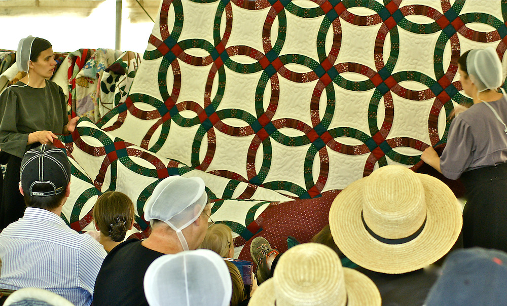 Amish auction off quilts at a fundraiser in Reading, Pennsylvania.