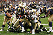 ST. LOUIS - SEPTEMBER 23:  Running back Steven Jackson #39 of the St. Louis Rams pulls away from a tackle by defensive tackle Willie Whitehead #98 of the New Orleans Saints while rushing for 97 yards and 2 touchdowns at the Edward Jones Dome on September 23, 2005 in St. Louis, Missouri. The Rams defeated the Saints 28-17. ©Paul Anthony Spinelli *** Local Caption *** Steven Jackson;Willie Whitehead