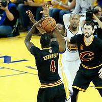 04 June 2017: Cleveland Cavaliers guard Iman Shumpert (4) takes a jump shot over Golden State Warriors forward Kevin Durant (35) during the Golden State Warriors 132-113 victory over the Cleveland Cavaliers, in game 2 of the 2017 NBA Finals, at the Oracle Arena, Oakland, California, USA.