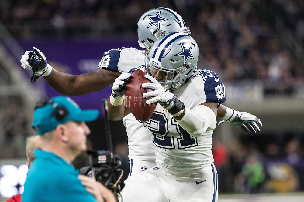 Dec 1, 2016; Minneapolis, MN, USA; Dallas Cowboys running back Ezekiel Elliott (21) celebrates his touchdown with Dallas Cowboys wide receiver Dez Bryant (88) during the second quarter at U.S. Bank Stadium. Mandatory Credit: Brace Hemmelgarn-USA TODAY Sports