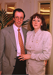 The HON.PETER & MRS HARRIS, he is the son of Lord Harris of Peckham, at a reception in London on 11th February 1998.MFI 1