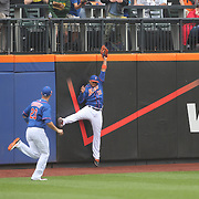 Center Fielder Juan Lagares, New York Mets, robs Jay Bruce, Cincinnati Reds, of a home run as he makes a catch at the wall during the New York Mets Vs Cincinnati Reds MLB regular season baseball game at Citi Field, Queens, New York. USA. 28th June 2015. Photo Tim Clayton