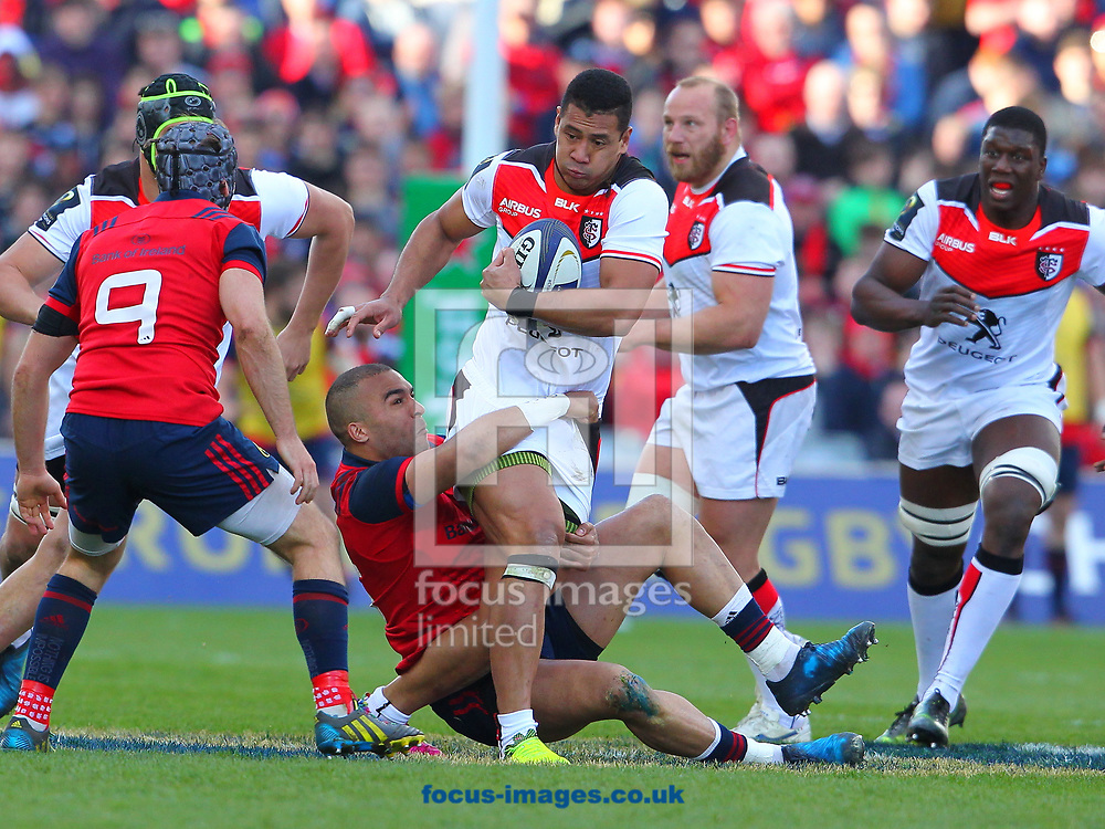 Simon Zebo of Munster and Paul Perez of Stade Toulousain during the European Rugby Champions Cup match at Thomond Park, Limerick<br /> Picture by Yannis Halas/Focus Images Ltd +353 8725 82019<br /> 01/04/2017