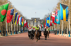 © Licensed to London News Pictures. 16/04/2018. London, UK. Horses ride down the Mall as part of 'Changing of the Guard', as the Commonwealth Heads of Government Meeting London 2018 takes place. There is a high level of security in Central London due to the meetings. Photo credit : Tom Nicholson/LNP