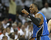 CHARLOTTE - APRIL 24:  Center Dwight Howard #12 argues with a referee and receives a technical foul during the game between the Charlotte Bobcats and the Orlando Magic in Game Three of the Eastern Conference Quarterfinals during the 2010 NBA Playoffs at Time Warner Cable Arena on April 24, 2010 in Charlotte, North Carolina. NOTE TO USER: User expressly acknowledges and agrees that, by downloading and/or using this photograph, user is consenting to the terms and conditions of the Getty Images License Agreement.  (Photo by Mike Zarrilli/Getty Images) *** Local Caption *** Dwight Howard