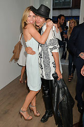 ABBEY CLANCY and DAMON BAKER at the Calvin Klein Jeans X mytheresa.com launch the Re-Issue Project at 37 Rathbone Street, London on 17th July 2014.