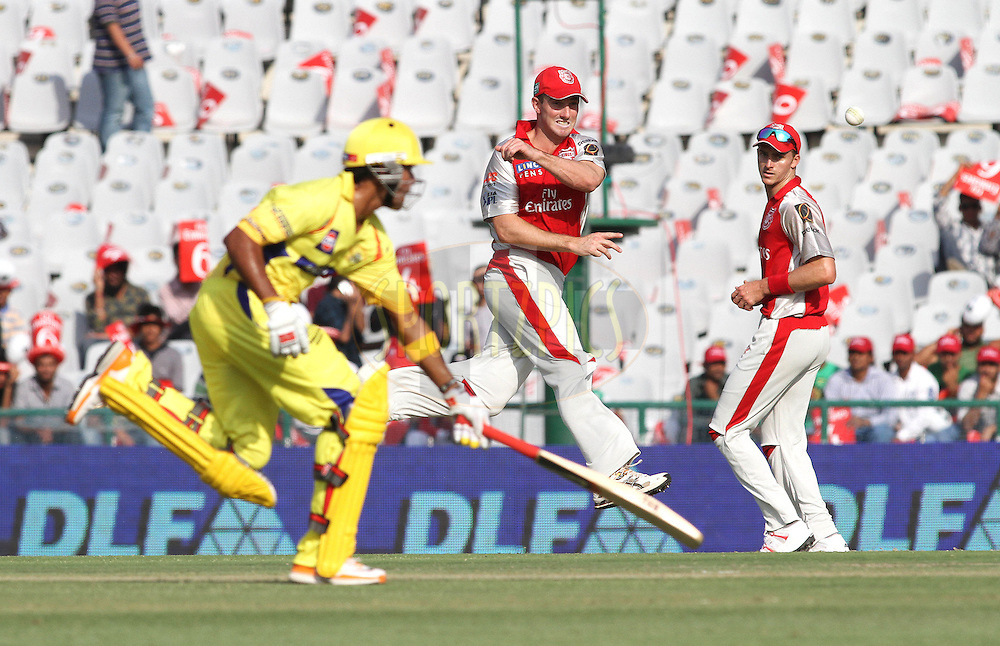Shaun Marsh of the Kings XI Punjab throws in while attempting to run out Subramaniam Badrinath of the Chennai Super Kings during match 9 of the Indian Premier League ( IPL ) Season 4 between the Kings XI Punjab and the Chennai Super Kings held at the PCA stadium in Mohali, Chandigarh, India on the 13th April 2011..Photo by Shaun Roy/BCCI/SPORTZPICS
