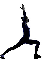 woman exercising Virbhadrasana I warrior pose yoga silhouette shadow white background