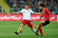 Chorzow, Poland - 2018 March 27: (L) Taras Romanczuk from Poland fights for the ball with (R) Lee Jae-sung from South Korea while Poland v South Korea International Friendly Soccer match at Stadion Slaski on March 27, 2018 in Chorzow, Poland.<br /> <br /> Mandatory credit:<br /> Photo by © Adam Nurkiewicz / Mediasport<br /> <br /> Adam Nurkiewicz declares that he has no rights to the image of people at the photographs of his authorship.<br /> <br /> Picture also available in RAW (NEF) or TIFF format on special request.<br /> <br /> Any editorial, commercial or promotional use requires written permission from the author of image.