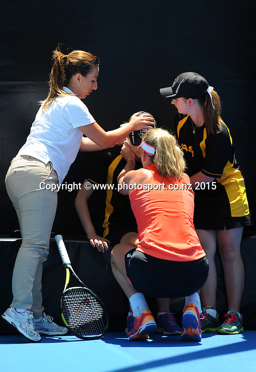 CoCo Vandeweghe from the USA helps a ball girl who was feeling unwell on Day 3 of the ASB Classic Women's International. ASB Tennis Centre, Auckland, New Zealand. Wednesday 7 January 2015. Copyright photo: Chris Symes/www.photosport.co.nz