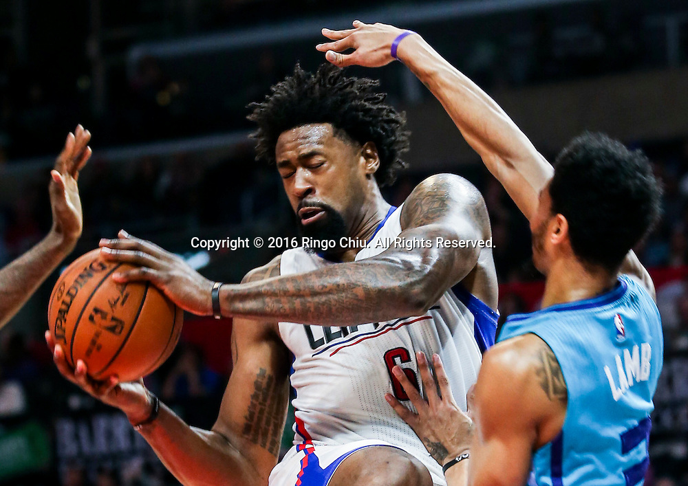 Los Angeles Clippers DeAndre Jordan defended by Charlotte Hornets Jeremy Lamb during the NBA basketball game in Los Angeles, the United States, Jan. 9, 2016. Los Angeles Clippers won 97-83. (Xinhua/Zhao Hanrong)(Photo by Ringo Chiu/PHOTOFORMULA.com)<br /> <br /> Usage Notes: This content is intended for editorial use only. For other uses, additional clearances may be required.