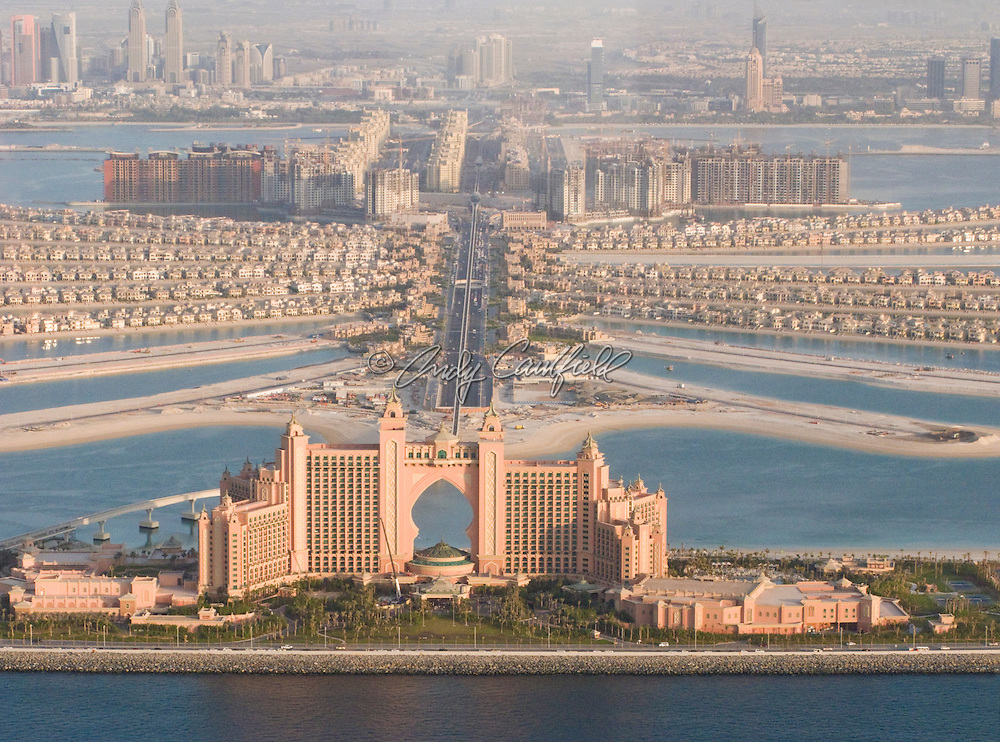 Aerial view of Palm Jumeirah, an artificial, man-made, island off the coast of Dubai in the Persian Gulf, created for residential, hotel and entertainment use. Constructed by property developer Nakheel Properties. Atlantis Resort in foreground. Dubai, UAE.