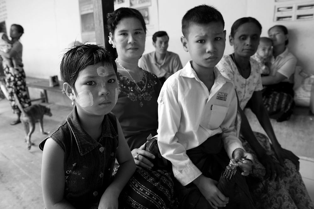 A burmese migrant family wait for treatment at the Mae Tao clinic. The Mae Tao Clinic (MTC), founded and directed by Dr. Cynthia Maung, provides free health care for refugees, migrant workers, and other individuals who cross the border from Burma to Thailand in search of of medical treatment.