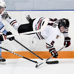 NEWMARKET, ON - Feb 13 : Ontario Junior Hockey League Game Action between Newmarket Hurricanes Hockey Club and Burlington Cougars Hockey Club.  Justin Maiolino #21 of the Newmarket Hurricanes Hockey Club catches some air during third period game action.<br /> (Photo by Phillip Sutherland / OJHL Images)