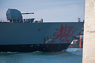 The Welsh dragon on the bow of HMS Dragon as she sails into her home port of Portsmouth for the first time in two months.  The Type 45 destroyer has been on a deployment involving exercises with the U.S. Navy and also a visit to the British Overseas Territory of Gibraltar.