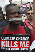 Global Day of Action protester marches on the streets of Durban, South Africa, 3 Dec 2011