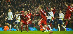 LIVERPOOL, ENGLAND - Wednesday, January 20, 2010: Liverpool's Dirk Kuyt celebrates after scoring his first penalty, but the referee forced a re-take, during the Premiership match against Tottenham Hotspur at Anfield. (Photo by: David Rawcliffe/Propaganda)