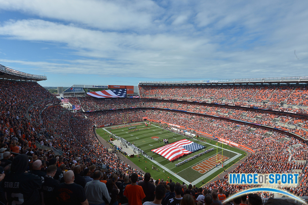 Sep 27, 2015; Cleveland, OH, USA; General view of the playing of the national anthem with a  United States flag on the field before the NFL game between the Oakland Raiders and the Cleveland Browns at FirstEnergy Stadium.