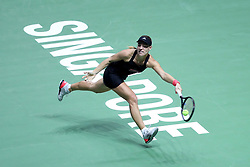 October 24, 2018 - Singapore - Angelique Kerber of Germany returns a shot during the match between Angelique Kerber and Naomi Osaka on day 4 of the WTA Finals at the Singapore Indoor Stadium. (Credit Image: © Paul Miller/ZUMA Wire)