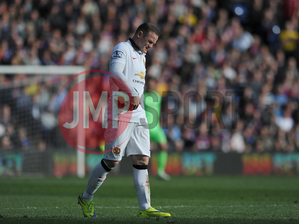 Manchester United's Wayne Rooney walks off in a pain after picking up the match ball. - Photo mandatory by-line: Alex James/JMP - Mobile: 07966 386802 - 09/05/2015 - SPORT - Football - London - Selhurst Park - Crystal Palace v Manchester United - Barclays Premier League