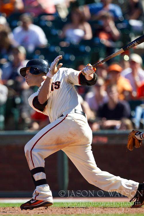 May 30, 2010; San Francisco, CA, USA;  San Francisco Giants second baseman Freddy Sanchez (21) hits an RBI single against the Arizona Diamondbacks during the ninth inning inning at AT&T Park.