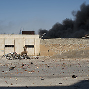 August 15, 2012 - Aleppo, Syria: View of the aftermath of an explosion cause by a Syrian army air strike on a communication center in northern Aleppo. (Paulo Nunes dos Santos/Polaris)