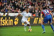 Wayne Routledge off Swansea City is marked by Martin Kelly of Crystal Palace.<br /> Barclays Premier league match, Swansea city v Crystal Palace at the Liberty stadium in Swansea, South Wales on Saturday 29th November 2014<br /> pic by Phil Rees, Andrew Orchard sports photography.